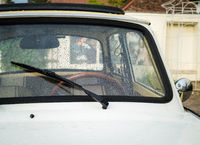 Old car with water droplets on the windscreen