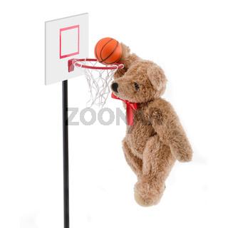 Teddy bear playing basketball dunking the ball