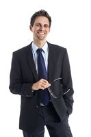 Successful businessman with glasses in hand