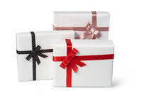 white present paper boxes with ribbon bow