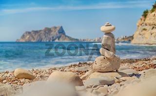 Art of stone balance, piles of stones on the Cala Baladrar beach. Costa Blanca. Spain