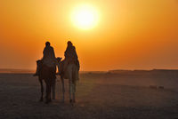 two camel rider in the desert at sunset