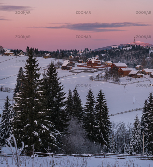 Small and quiet alpine village and winter sunrise snowy mountains around, Voronenko, Carpathian, Ukraine.