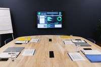 Conference room statistics displayed on monitor prepared for meeting