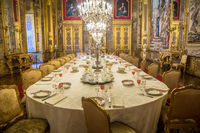 Luxury Baroque dining room with gala dinner table setting