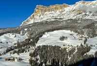 Mountainous winter landscape with peak Sasso di Santa Croce, Alta Badia, Dolomites, Italy