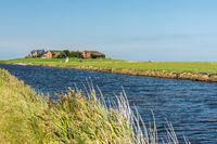 Typical Terp with Tidal Creek in Foreground at Hallig Hooge in North Frisia, Wadden Sea, Germany