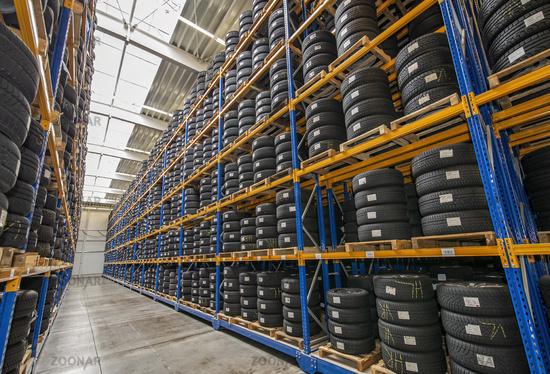 Tire warehouse with high shelf