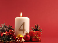 White candle with the number four burns, Advent background