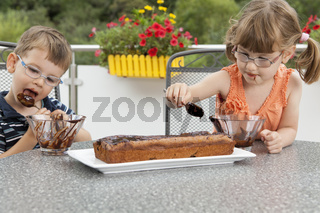 Kids decorating the chocolate cake