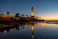 horizontal view of the Chipiona lighthouse in Andalusia at sunset