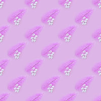 Seamless texture of pink feather and eggs on a pink background. Easter concept.