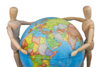 wooden puppets embracing globe
