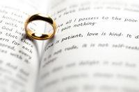 Golden wedding ring on bible book