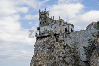 Swallow's nest castle on a steep cliff is a tourist attraction in the Republic of Crimea, Russia. Cloudy day September 9, 2020