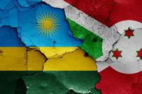 flags of Rwanda and Burundi painted on cracked wall