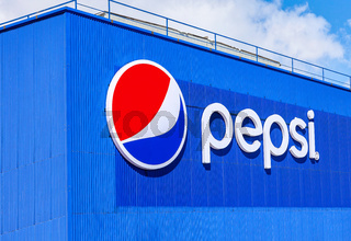 Brand name of Pepsi Corporation on the wall of factory