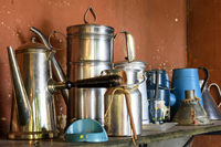 Old and used coffee pots on brazilian farm
