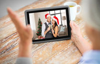 old woman has video call with family on christmas