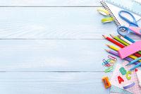 Colorful stationery on blue desk