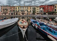 Lazise harbour on Lake Garda in Italy in the morning