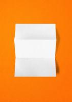 Blank folded White A4 paper sheet mockup template on orange background