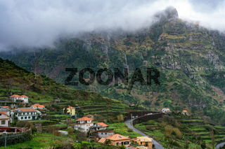 Village and beautiful mountains with clouds, in Madeira