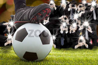 many photographer taking winner soccer player feet on field