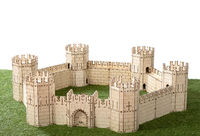A little model of a plywood castle on an isolated background.