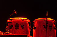 Steel drums illuminated on a stage