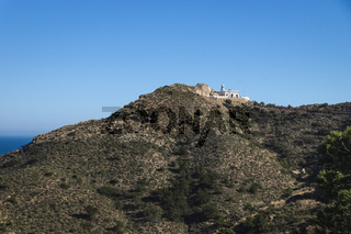 Lighthouse on top of mountain in natural park 'Serry Gelada' in Albir, Spain