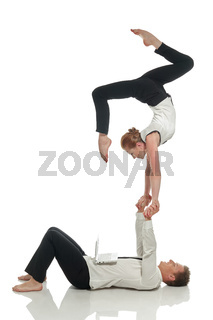 Acrobatic business people doing handstand in pair