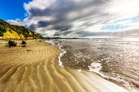 Moeraki's huge boulders on a sandy beach