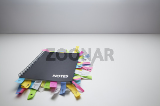 Notepad full of post it notes