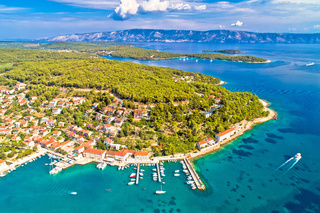 Town of Jelsa bay and waterfront aerial view