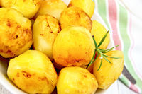 Potatoes fried on plate with napkin