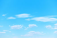Light blue sky with clouds -  natural background