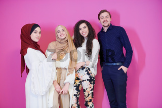 group portrait of young muslim people isolated on pink