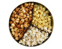 Three different styles of popcorn, buttered, cheese, and caramel, in a round tin. High angle isolated on white.