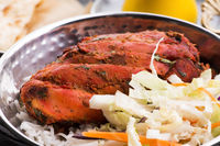 Close-up of a plate of chopped tandoori chicken