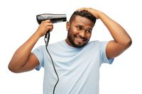 african american man with fan or hair dryer