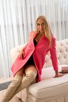 Stylish female traveler with suitcase at hotel room