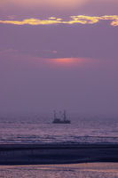 Ship and sunset at the seaside with pastel colors