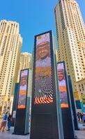 Towers of Dubai Marina and advertising screens