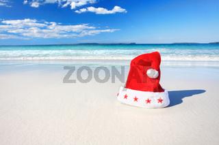 Christmas Santa hat on sunny beach in Australia