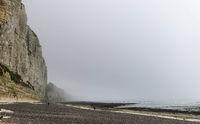 Misty morning fog landscape on the cliffs of Etretat in France