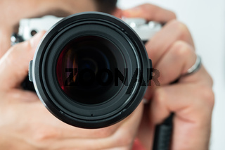 Man taking a photo holding a camera