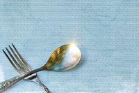 Vintage spoon and fork on grunge background