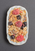 Vital muesli in a white bowl for food photography