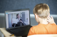 The remote teacher speaks via video link with the student. Online education and e-learning concept. Home quarantine, distance learning and work from home.